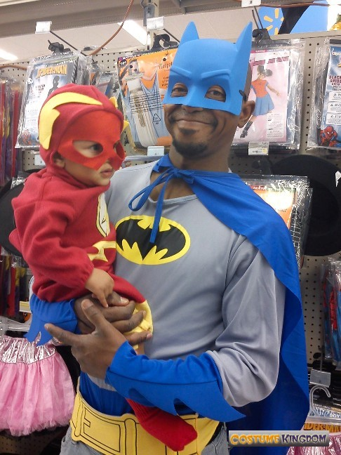 batman holding the flash